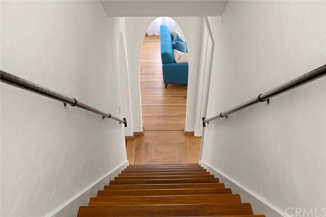 Original wrought iron railings, and inlaid hardwood floor patterns are just some of the charming features of the Spanish classic home...