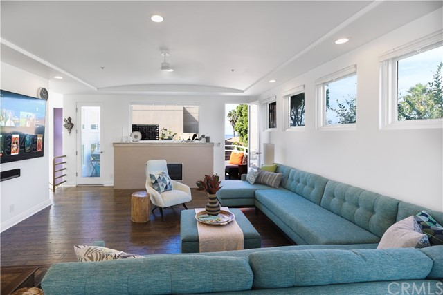 Spacious living room opens to ocean view deck