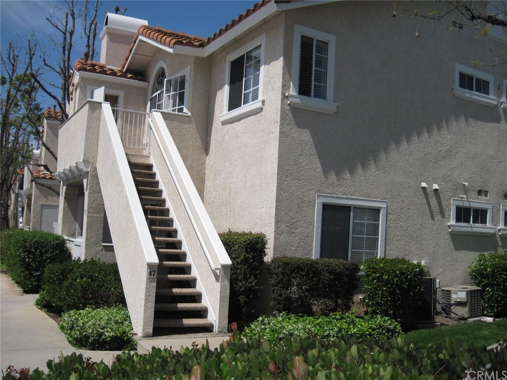 THIS PRIVATE, UPPER END UNIT IS NEAR PARKS, SCHOOLS, LAKE RSM AND SHOPPING! ENJOY UPGRADED FIXTURES, A ROMANTIC FIREPLACE, AND CUSTOM WINDOW COVERINGS. THE TWO BEDROOMS ARE SEPARATED BY THE LIVING AREA, EACH WITH ITS OWN BATH. INCLUDED ARE A REFRIGERATOR, WASHER AND DRYER, MAKING THIS SUNNY CONDO MOVE-IN READY. THE BALCONY IS PERFECT FOR A BBQ. THE COVERED CARPORT IS CONVENIENTLY LOCATED AT THE BOTTOM OF THE STAIRS! WITH LOTS OF GUEST PARKING AND A GREAT POOL AND SPA AREA,THIS CONDO OFFERS THE BEST OF ORANGE COUNTY LIVING.