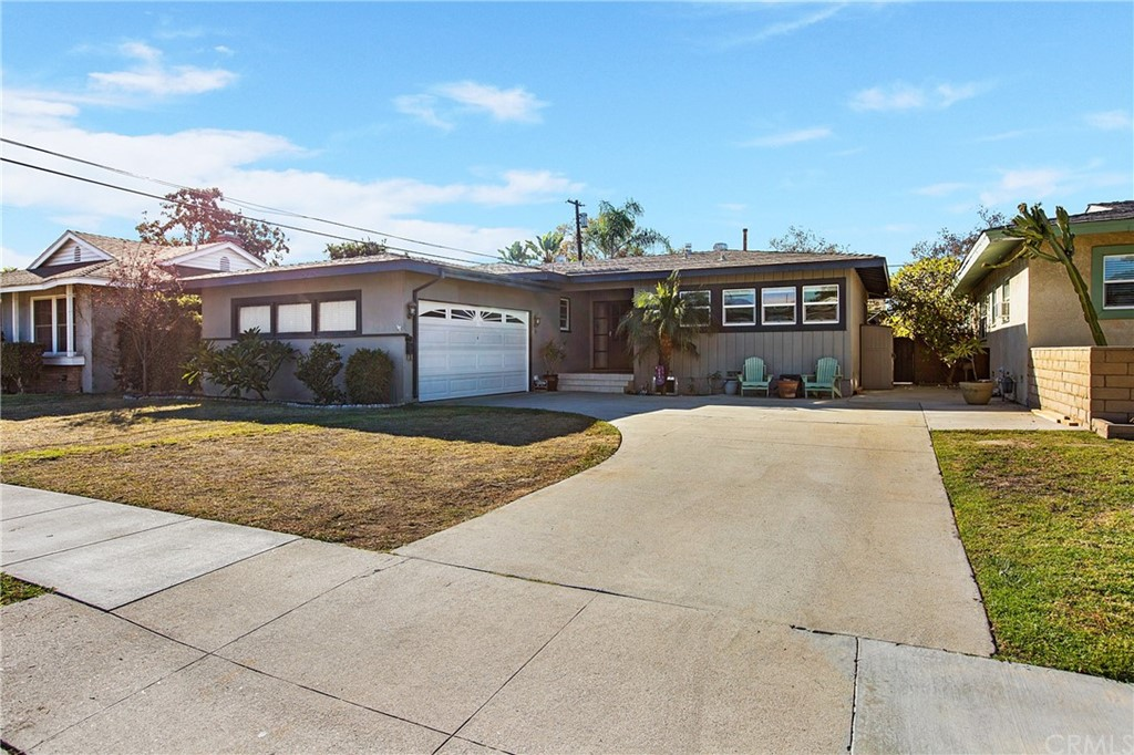Don't miss out on your opportunity to live in one of the most sought-after neighborhoods in all of East Long Beach.  This lovely 3 bedroom, 2 bathroom mid-century open-floor concept home has it all.  The kitchen has been remodeled with a modern flair that is clean and crisp with a farmhouse sink, stone & cutting block counters, industrial open-faced shelving, white ceramic tile walls, tile floors, stainless steel appliances and plenty of storage.  Gorgeous wood floors run throughout the rest of this home that features an over-sized living room with fireplace and large dual-paned windows that let in an abundance of natural light.  Both bathrooms have been tastefully updated – one with wainscotting and the other with a free-standing soaking tub surrounded by a subway-style tile wall covering.  Enjoy Avocados? Your new home has it's very own avocado tree – perfect for making avocado toast or guacamole as you enjoy relaxing or entertaining on your raised wooden deck overlooking your spacious yard.  If location is everything, this home has the best: cul-de-sac street across from Tincher Preparatory School (K-8 and highly rated), minutes from Belmont Shore, Seal Beach, Eldorado Park & Nature Center, CSULB, along with easy access (without burdensome noise) to the 405, 605 and 22 Freeways