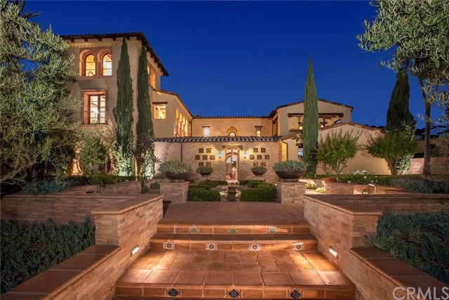 Live in this custom designed Andalusian inspired estate nestled in the prestigious Shady Canyon 24-hour guard gated community.  This alluring 9,600 sqft estate situated on a 23,183 sqft lot featuring 5 bd, 7.5 ba, 3 car garage is perfect for entertaining or relaxing in a secluded sanctuary. Main level features a formal living and dining room with rich hardwood & stone floors and vaulted ceilings, professional chef style outfitted kitchen equipped with Wolf, Sub-Zero & Miele appliances, a central island, marble countertops and custom cabinetry, 2 bedroom suites, a spacious office, a comfortable family room with grand fireplace and wall of folding glass doors extends to the outdoor entertaining area completed with a pool, spa, cascading waterfalls and outdoor grilling bar, enhancing the villa appeal of this magnificent residence. Upper level features a grand master suite with fireplace, covered terrace, walk-in closet, elegant bath and sizable retreat loft. 2 bedroom suites with custom closets and covered balconies, and a secondary laundry room completes this level. Subterranean level features a pool, sauna, home theatre/game room & bar, temperature controlled wine cellar/tasting room, and additional space ideal for studio/exercise room. Optional elevator to all levels included. You'll also enjoy the community's world-class resort style amenities including private Golf Club, pool, spa, clubhouse, outdoor recreational areas, tennis courts, and hiking, biking and walking trails.