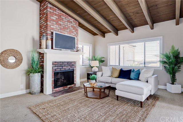 Enter the charming living area with vaulted ceilings and fireplace!