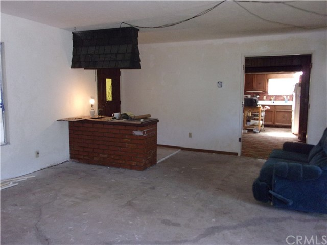 Portion of living room looking to kitchen