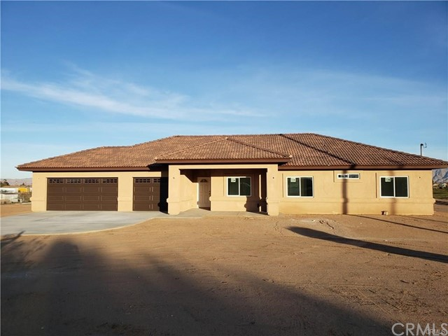 Brand new on 2 acres, this beautiful spacious home with 2 master suites is ready for you. Open floor plan with corner fireplace. 4 bedrooms with a den an 3 full baths. You will not be disappointed. Quartz counter tops throughout. In door laundry room. Ceramic tile floors that looks like wood.