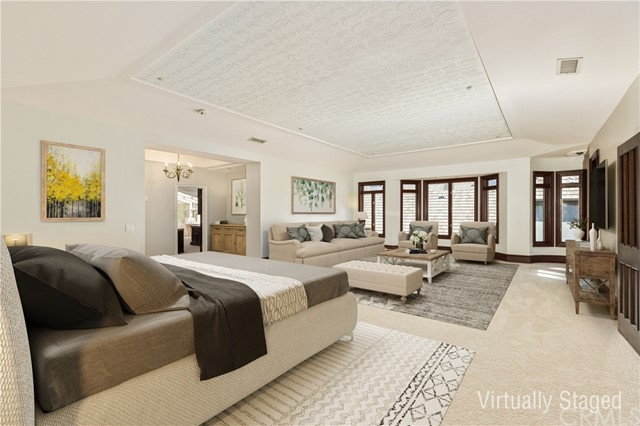 Master Bedroom -virtually renovated to show updated flooring, paint, furniture and decorative treatment.