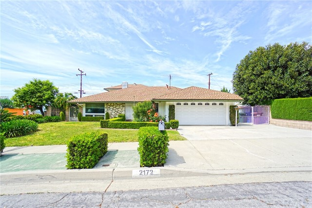 Warm and welcoming home in the hills of Hacienda Heights with gorgeous views! The home is located in one of Hacienda Heights' best neighborhoods close to Thomas Burton Park and the highly rated Mesa Robles School! With 4 beds, 3 baths, and 2,355 sqft, this south facing home has plenty of space for a large family. Through the entrance is a spacious formal living room accentuated with a 2 sided wrap around stone fireplace. The kitchen opens up into the family room that has an amazing picturesque view. On the first floor, there are 2 bedrooms and a master suite. Upstairs features a private and secluded bedroom boasting the best unobstructed view in the home. Option to add large balcony next to upstairs bedroom. The home also features a large bonus room perfect for a man cave or a she shed. Included is a 2-car garage with direct access and an oversize driveway with room for RV parking. The huge side and backyard features a nice pergola, perfect to sit back, relax, and enjoy the views. There are also many fruit trees surrounding the property with additional room to grow your own organic garden.