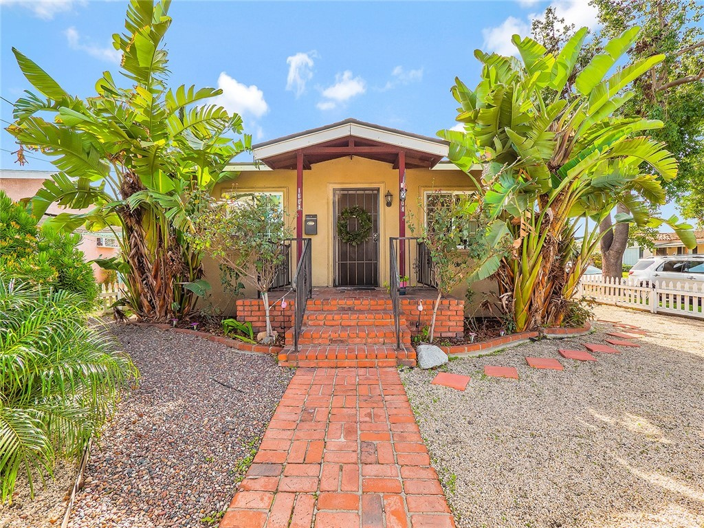 Welcome to 1604 E. 59th St in North Long Beach! Nestled between Lakewood & Bixby Knolls, this quaint 2 bedroom/1 bath California bungalow is conveniently situated on a corner lot.  Enter the property via a white picket fence, follow the brick walkway passing the drought tolerant landscape & reaching the beautiful traditional brick porch...reminiscent of another era. Laminate wood flooring lines most of the floors in the home with tiled bathrooms & kitchen.  Plenty of cabinetry in the kitchen to store all of a chef's essentials.  Dual pane windows throughout which allows plenty of natural light to illuminate the interior of the home.  Separate dining area with original built-ins a plus! Are you an entertainer at heart?  There's plenty of space in the front & rear yards of the home to host guests/family.  Plenty of privacy in the fully fenced rear yard allows you to enjoy the evening breezes while having your summer BBQ's.  Detached garage with access from Walnut Ave.  The laundry is located in the garage. Mature tree lined street a plus.  The home is in close proximity to shopping, schools, parks, and centrally located to the 710 & 91 freeways for convenience. Nearby parks include Jackson Park, Houghton Park & Biscailuz Park.  Walk Score® of 73, TransitScore® of 42 & BikeScore® of 62. This charmer has it all!