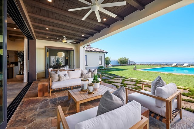 Covered patio leading from great room opens to backyard with the view. Model home shown.