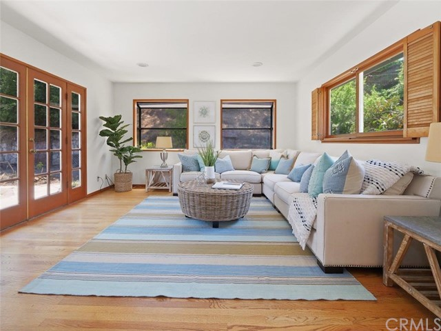 Family room off the dining area. The French Doors lead to the backyard