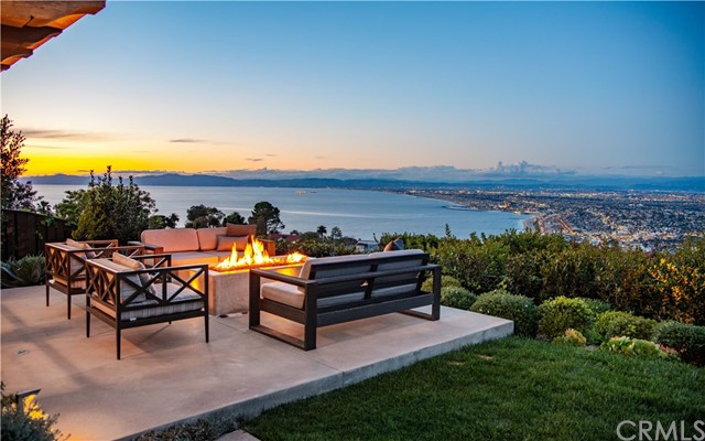 "You'll initially be drawn to the panoramic, ocean, coastline and city lights views, but you'll quickly discover that this incredible home, completed in 2015 has so much more to offer.  Measuring over 4,300 square feet of exceptional living space, this 5 bedroom 4 & 1/2 bath home is finished with amazing attention to detail and design throughout.  An enchanting courtyard welcomes you.  Once inside, you are greeted by the stylish living room with soaring ceilings and a masonry fireplace.  The formal dining room is flanked by a 102 bottle, Sub-Zero wine cabinet with dual zones for red and white wine.  The gourmet kitchen opens to a large family room with fireplace and custom cabinetry.  The bedroom level is highlighted by a stunning master suite with luxurious bathroom, walk-in closet and spectacular views.  The indoor / outdoor lifestyle is truly encouraged through walls of ""Nana-style"" French doors that lead to the saltwater pool & spa, built-in BBQ, fire pit, covered dining alcove and lush landscaping.  Some of the other features include a 3-car garage with custom storage, upgraded elevator, air conditioning, built-in speakers, and security system with cameras.  This is the epitome of the Palos Verdes lifestyle…  open spaces, privacy and natural beauty!"
