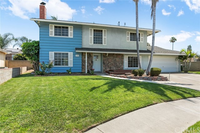 Beauty, sophistication, and luxury embodies this recently remodeled home in the city of Placentia. As you step through the front door, you'll immediately notice the bright, open, and airy layout. The living room features a fireplace and beautiful custom built in cabinets.  The living space opens up to the kitchen and dining area for easy entertaining. The chef's kitchen includes bright white shaker cabinets, beautiful quartz counters, stainless steel appliances, an oversized penninsula,  and a huge white farmsink. There is a room downstairs perfect for guests, office, or home gym.  A beautifully remodeled half bath and a large laundry room with plenty of storage round out the downstairs space.  As you walk up the stairs, you'll notice the brand new carpet and beautiful railings.  Enter into your spacious master suite which includes a remodeled bathroom with sleek modern fixtures.  Four spacious bedrooms and a full bathroom with designer amenities round out the upstairs space.  The resort like backyard includes a patio, children's playset area, and a sparkling pool perfect for entertaining.  Some of the other amenities of the home include plantation shutters, smart thermostat, solar panel system, whole house fan, and a tankless water heater. Centrally located near freeways, shopping, and great schools, don't miss out on this opportunity to live in your dream home!
