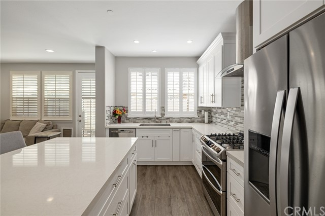 updated kitchen with Shaker style cabinets, Quartz countertops and stainless steel appliances