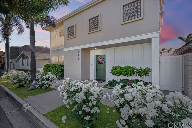 SIGNIFICANT PRICE REDUCTION - OPEN SUNDAY JUNE 13, 1-4PM: Welcome to 125 Via Genoa, a delightful three-bedroom, three-and-a-half bath, 2500 square-foot home situated on a 40' lot in an ideal location on exquisite Lido Isle. From the inlaid-marble entrance foyer to the peaceful center patio bathed in afternoon sunshine, this home is an inviting respite from daily life. A beautifully executed traditional formal living room houses a limestone fireplace for staying cozy on chilly nights and French doors that open to the enchanting patio with fountain. Large corner windows flood the room in natural light, while custom millwork and built-ins indicate quality construction with attention to detail. The formal dining room offers myriad built-ins and a charming fireplace and is also steps from the sunny outdoor living space. A Chef's kitchen features dual Viking ovens, a La Cornue range, a SubZero fridge and an expansive Calcutta Gold marble island with breakfast bar. A downstairs bedroom and bath as well as a laundry room adjacent to the two-car garage complete the first floor. Upstairs, private living quarters include two en-suite bedrooms: one a spacious, comfy Master with three closets and a spa-like Master bath with dual vanities and soaking tub. The third bedroom is bordered by a wall of bay-facing windows to allow for fresh ocean breezes and contains a well-appointed bath with a marble-tiled shower and flooring as well as a walk-in closet. Further conveniences include a downstairs powder room and butler's pantry, along with plenty of built-in storage throughout. Positioned on a wide-open street just steps from the grand tree-lined Piazza and the Genoa boat garden and playground, this residence is the perfect island home.