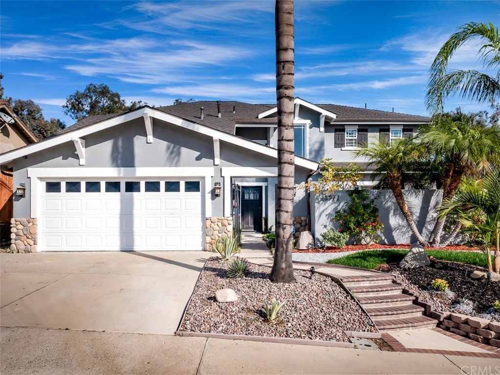 Exquisite, Remodeled, Move In Ready Home near Entrance To Arroyo Trabuco Golf Club. 4 BR or 3BR + Bonus, 3.5BA , 2750 SQ FT! Surrounded by View of Lush Green Hills, Gorgeous Turn Key Home ! Beautiful Landscaping, Majestic Palms, & Stunning Craftsman Exterior. Inside Front Gate is Pond with Bridge, Gold Fish, 3 Friendly Turtles & Waterfall. This Private Patio is So Serene!! The Perfectly Maintained Home has Tile Floors, New Carpet, much New Paint, Dual Pane Windows, newer High-End HVAC, Recessed Lighting, Recessed Built-in Ceiling Speakers, 2 Bedrooms on Main Floor (1 with it's own Full Bathroom) & the other with access to another Full Bath in the Hall. 1 Year New Kitchen is  Amazing, with Stainless Steel Gas Range, MW, Refrigerator & DW! Tons of Quartz Counter Space, Custom Gorgeous Soft Close Cabinets & Drawers, Breakfast Bar & Garden Window!!! Upstairs is the Giant Romantic Master Suite w 2-Sided Fireplace, Walk-In Closet & Door to a huge Deck with a Spiral Staircase down to Great Backyard. Master Bath has Jetted Tub & Huge Custom Double Shower. The Enormous Media Room (or 4th bedroom currently no closet) is Perfect for Your Media Devices & includes a Wet Bar, Refrigerator & a Half Bath & also access to Upstairs Deck. Backyard Patio has a Custom California Room, Built-in BBQ, a Fire & Ice Fire Pit, Room for Fabulous Parties!  Spacious Patio is Plumbed for Spa. No HOA, No Mello Roos, & low Tax Rate of 1.01% Hurry This is a Beauty! 2 MASTER BEDROOMS --- 1 UP  & 1 DOWN
