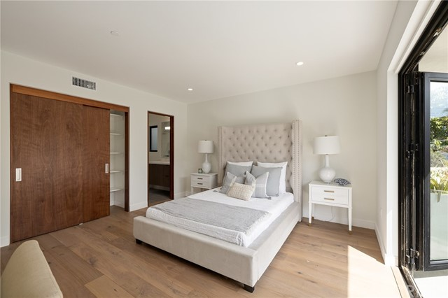 Spacious bedroom with private bath and generous closet space (shown here using reverse of 961 Unit A staging)