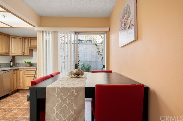 Dining area leads to the patio for barbeque.