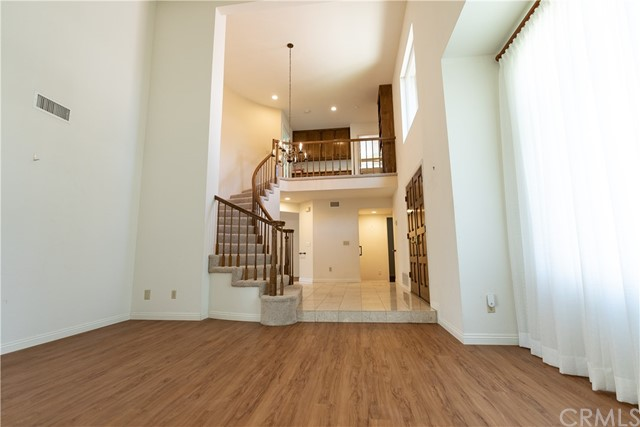 View of entry and upstairs hallway from Living Room