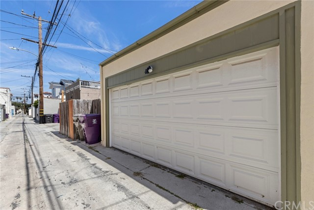 Access to enter the garage in conveniently off the adjacent alley.....