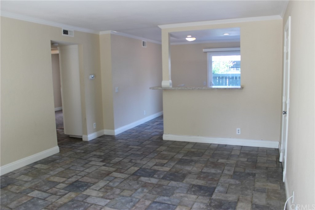 Very nicely upgraded downstairs corner unit with 2 patios. Ceramic tile in kitchen, living room, hallway, large closet, and both bathrooms. Newer kitchen with stainless steel appliances, quartz counter tops, large farmer stainless sink, and newer cabinets. Recessed lights, scraped ceilings, carpet in both bedrooms, mirrored wardrobes in both bedrooms, and full size washer and dryer cabinet off front patio. Property also has central A/C and both bathrooms are redone with newer vanities with quartz, newer shower doors, and newer sink faucets. The rear patio has an access gate to your carport parking space next to the gang mailbox #4. Easy to show, no Mello-Roos, and will go fast.