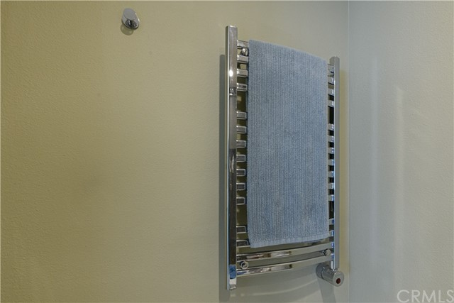 Towel Warmer--control can be programmed to turn on and off at desired times each day