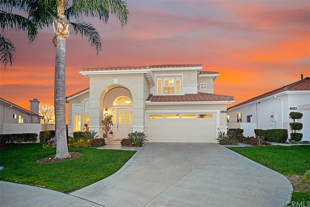 This is the largest floor-plan in the popular 55+ (SENIOR) gated community of Palmia featuring PANORAMIC SUNSET, CITY & MOUNTAIN VIEWS and is superbly located on a SINGLE-LOADED street.  The formal living & dining rooms include crown molding, high ceilings, plantation shutters & timeless stone flooring.  BONUS! The home has been RE-PIPED so you'll rest knowing you won't have a slab leak. INSTANT HOT WATER, WATER SOFTENER & INSIDE LAUNDRY are just some of the many other impressive features to appreciate. The kitchen is equipped with granite & corian countertops, double ovens, induction cooktop,  a small island & is open to a cozy den with in-ceiling speakers, a built-in bookcase, warm fireplace, newer slider & windows which overlook the backyard. MAIN FLOOR MASTER BEDROOM w/crown molding, updated bath, walk-in shower & soaking roman tub. Upstairs you have 2 additional large bedrooms w/ceiling fans, big closets, a full bath & a spacious loft which can be used as an office.  Delight in the backyard w/breathtaking SUNSET VIEWS & multiple firework shows in the summer. A soothing fountain, an aluminum patio cover, lemon & orange trees are all part of the backyard. Tennis courts, pool & spa, 18 hole putting green, billiards, PICKLEBALL, tons of clubs & classes to enjoy. Mission Viejo perks include the lake, with fishing, sailing, summer concerts w/SPECTACULAR FIREWORK shows! This is a wonderful community to make friends & enjoy a fun lifestyle. This one won't last! NO Mello Roos.