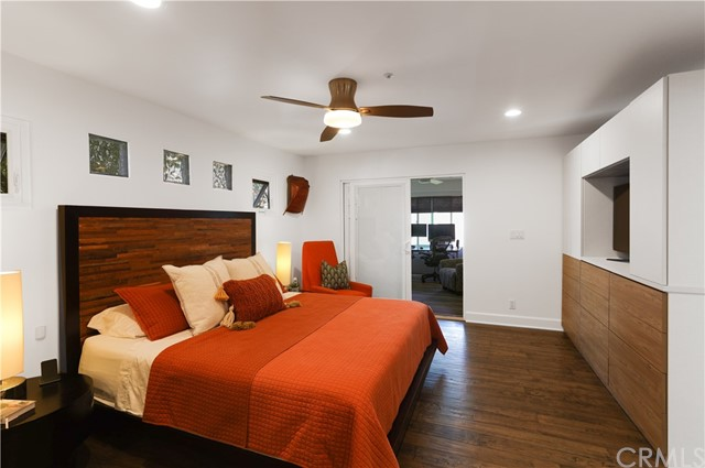 Primary suite bedroom, spacious, easily fits king size bed & tables