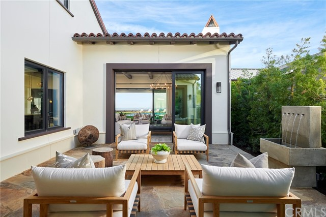 Private courtyard at the entry of this home opens to the great room and backyard. Model home shown.