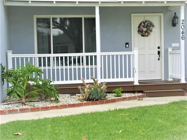 Move-in ready! 3 bedroom home. Updated kitchen, new flooring, central air conditioning, Fireplace in Living room. 2 car garage and access from alley (possible RV parking).