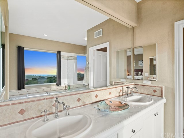 Master bath has dual vanities, thermostatic fixtures, and a soaking tub with views!