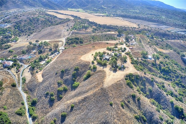 LOCATION...LOCATION...LOCATION.... RARE AND ONCE IN A LIFETIME OPPORTUNITY  TO OWN PRIME REAL ESTATE.   *** Beautiful ... Panoramic Views of Mountains & City Lights!!!  .... Truly One of a Kind .... ((( Investment Opportunity for a savvy  developer and/or  investor  )))...... 14.97 acres on top of the hill and secluded .... it is located 5 minutes off the 15 fwy at Weirick Rd in the foothills of the Cleveland National Forest and 5 minutes from Dos Lagos and The Crossings for Major shopping.  3 bed 1 bath. There are multiple opportunities for the land!