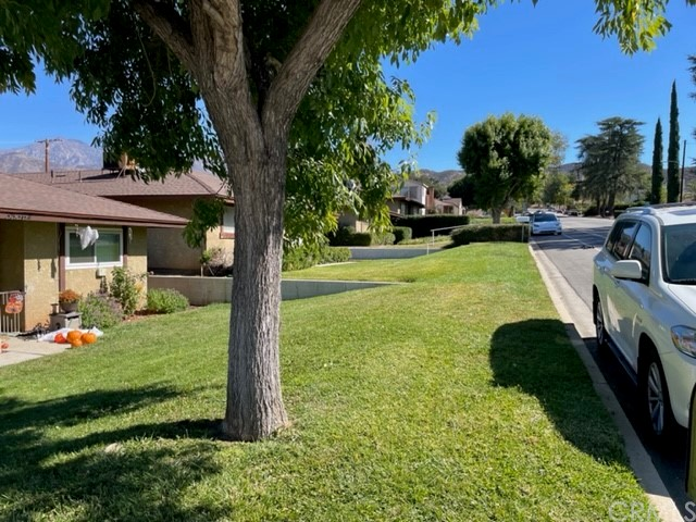 Hurry! Come see this beautiful 2 bedroom 2 bathroom condominium it won't last.  You will come to a nice spacious front patio with room for a garden than you will enter into the Large living room, that features new flooring thru out the house , fresh paint than you will see the dining area /  large kitchen with granite counter tops, brand new cabinets. On the right side of the house you will find both bedrooms very spacious rooms closets are large as well and both bathrooms. As you go outside you will find a small patio and stairs that lead you to the detach garage.