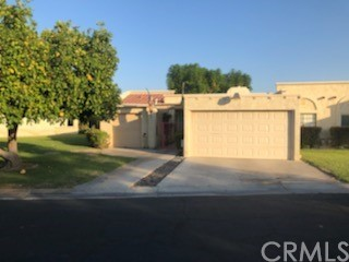2/2 with an office (can be considered 3rd bedroom) that can be used as an extra room. The entire kitchen was remodeled with new appliances and new cabinets when seller bought in 2019.. 1 car Garage along with a golf cart garage. Very close to the clubhouse. There are (3) 9 hole golf courses on premises with a newly remodeled clubhouse. Quiet neighborhood with great neighbors. The floors are concrete stained. The HOA is hiring a new Landscape company to clean it up. The front gate is being painted this week. See private remarks for HOA fees and what it covers.