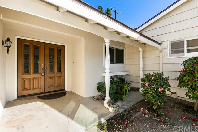 Here's a fantastic opportunity to own a SPRAWLING SINGLE STORY RANCH HOME in a SOUGHT AFTER ORANGE NEIGHBORHOOD!  This attractive floor plan features lots of living and entertaining space and THREE WOOD BURNING FIREPLACES!  With fresh paint in and out, it's MOVE-IN READY!  The BEAUTIFULLY REMODELED KITCHEN boasts STAINLESS STEEL BOSCH APPLIANCES, granite counters and hardwood cabinetry with soft close drawers and cabinets.  Both the SPACIOUS LIVING ROOM and SEPARATE FAMILY ROOM HAVE WOOD BURNING FIREPLACES and overlook the rear yard.  There's both a large dining area and a breakfast counter.  A separate office/hobby room is off the dining area.  The LARGE MASTER SUITE has a separate shower and tub, FIREPLACE and WALK-IN CLOSET.  Both secondary bathrooms are updated with deluxe vanities.  Enjoy a separate INDOOR LAUNDRY ROOM, along with CENTRAL AIR CONDITIONING and a 1 year old roof.   An oversized garage has a nice workshop area and direct access to the home.  The HUGE REAR YARD has a covered patio, sparkling pool and spa and plenty of grass and garden area.  It's a close walk to great schools – LaVeta Elementary and McPherson Magnet!