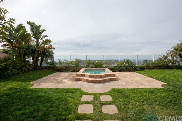 This stunning 4 bed, 2.5 bath Newport Coast home sits secluded at the end of a cul-de-sac, privately tucked behind the gates of the prestigious Campobello community with a million-dollar coastal view! From the comfort of your own private jacuzzi, soak up the sun while taking in the views of Newport Coast, Catalina Island, Buck Gully Reserve, and San Joaquin Hills. A grand entry welcomes you to this Mediterranean dream home adorned with travertine floors, 2-story ceilings, and tons of windows. This home is the definition of light and bright. A grand kitchen features granite counters, stainless steel appliances (incl. fridge without warranty), and more VIEWS! Enjoy coastal views while cooking! You'll love the open floorplan. The master suite will blow you away with a large walk-in closet, his/hers sinks and vanity, soaking tub, walk-in shower, and privacy toilet room. The backyard is a real treat with a stone patio for grilling and outdoor living, a grass lawn, and a private jacuzzi facing some of the finest views in OC. Plus, a laundry room and three-car garage with epoxied floors provide added convenience with plenty of storage space! Community amenities include: pool, spa, tennis courts, and neighborhood parks. A short drive from some of the finest dining and shopping in Orange County, this house is the place to call home!