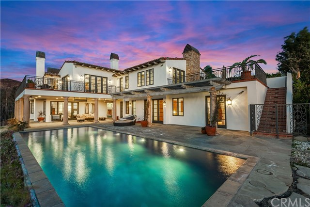 A true dream home requires four elements: *space* for you and yours to live comfortably, *privacy* to truly be yourself, *views* to inspire and *luxury* to delight. And nowhere do these elements coalesce more beautifully than 5941 Kanan Dume Rd. Space: A romantic, 6,600+ SF Mediterranean estate perched on 4.3 acres of rolling Malibu hillside means room for everything and everyone – inside and out. And your very own mature, producing vineyard means the space that gives you room to breathe also gives you wine to savor. Privacy: Your tranquility is ensured by a gated entrance and a dramatic driveway that lazily winds through your vineyard… the real world couldn't be further from your mind. Inside, five generous ensuite bedrooms with direct access to multiple outdoor living spaces means that each guest has their own private enclave… without leaving the home. Views: The estate's beauty extends beyond its boundaries. Your views – framed by your vineyard in the foreground – include the legendary Malibu hills, the intoxicating Pacific Ocean and a nightly light show in the sky that stuns every single time. Luxury: It's rare to find a home that lacks nothing. But with a resort-like pool & spa, two levels of outdoor living, a private tasting room, a climate-controlled wine cellar, an in-home movie theater, a zen atrium and a convenient elevator, only one thing is missing from 5941 Kanan Dume Rd: someone to enjoy it. So raise a glass in celebration, because today your dreams became real.