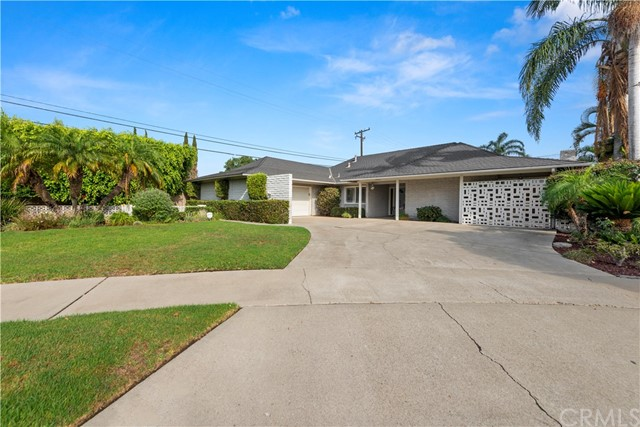 Welcome!  Fall in love with this Mid Century Modern Home with cul-de-sac location in the City of Orange!  This property has good bones!  This 4 bed, 2 bath SINGLE story POOL home, offers a fabulous location & floor plan!  Upon opening the double front doors you will find a rare Terrazzo title flooring in the entry.  Walking further you enter into LARGE, living room, complete w/fireplace & large hearth perfect for your Holiday gatherings! Large blanket of windows overlooking the kidney shaped pool, and living room flows into dining room. MASTER bedroom is located in its own wing of home. Beautiful NEW master bath just completed, Cool Bluetooth mood light above shower! New flooring in bath & master.  Loads of closets & windows!  Moving into the kitchen you will find a large skylight above stove, double sliding doors to grassy backyard, fruit trees & patio.  Beautiful hardwood floors in kitchen & family room! Nice size additional 3 bedrooms, one with unique brick wall.   LG laundry, loads of storage space, attached 2 car garage.  FRONT yard i grassy area.  Large DRIVEWAY!  Conveniently located for easy freeway access.  PLEASE VIEW PICTURES & 3D VIRTUAL TOUR.  Owners seeking Serious Qualified buyers during this COVID time.  Qualifications will be verified before owner responds to any offer, NO exceptions. Thank you for understanding during this COVID time. Same owners since 1972,   This property is offered FOR SALE ONLY. & sold AS IS.   SINGLE stories go quickly, act today!