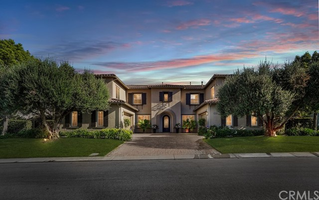 Rarely does an estate of this magnitude become available. Original owners have created an oasis of chic comfort & prosperity in this stunning 5 bed, 5.5 bath, 5,638 Sqft Cul-de-sac home. This home offers sprawling sunrise, hillside, city lights, ocean, Catalina, & sunset views. The classic & modern salt water pool & spa overlooks all of Yorba Linda coupled with fireplace seating, built in BBQ with seating for 6+, covered casita as well as putting green. This 15,197 Sqft lot offers an expansive covered back patio for indoor/outdoor living year round with outdoor bar just off the homes custom built wine cellar. Mature olive trees flank the home, dual two car garages & grand dual staircase are just the beginning of this thoughtful estate. Entering the home is a formal dining area to the left with butlers pantry, walk in pantry & direct access to kitchen. To the right is a formal seating area with fireplace & custom wine cellar with sink & refrigerator. The great room offers chefs kitchen with dual sinks, top of the line appliances, oversized island with seating for 4+, & secondary refrigerator. The family room offers ample natural light, fireplace, desk area & a gorgeous view of the backyard. Downstairs offers a dedicated office & oversized secondary master suite with walk in closet, large enough for home theater. Upstairs has two separate wings, split by the landing at the top of the stairs offering sprawling views off the back of the property & built in study area. The secondary wing offers 3 ensuite bedrooms with full bathroom & walk in closet. Large common area sits between the 3 bedrooms making the perfect landing place for gathering. The primary wing offers dedicated seating area, coffee/wine bar with sink, wine fridge, & microwave, bedroom has fireplace & large balcony with breathtaking views & hidden staircase down to pool & spa. Master bath offers his & hers; vanities, toilets, & oversized closets with built ins, large soaker bathtub, walk in shower with dual 
