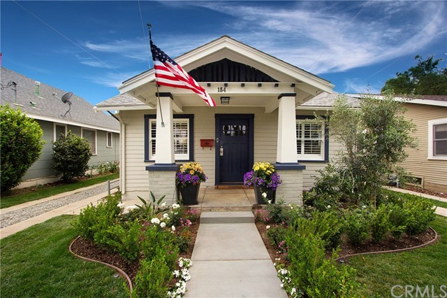 Love where you live! Historic Craftsman style home walking distance to Old Towne Orange and Chapman University.  Historic charm meets modern conveniences in this beautifully remodeled 3 bedroom 2 bath home. Bright and light living room with wood windows and cozy fireplace. Spacious dining room area with charming built in hutch that leads to the remodeled kitchen with shining quartz countertops and stainless steel appliances. Three bedrooms with ample closets and nicely remodeled bathrooms. Enjoy the back yard with lovely patio and beautiful landscaping. Turn the detached studio into your own office, art studio or gym. You are not just buying a home here, you are investing in a lifestyle where you can stroll down tree lined streets with beautiful historic homes to the many shops and fine restaurants Old Towne Orange has to offer. College close makes it great for investors too!  Come take a look and make this beautiful house your new home.