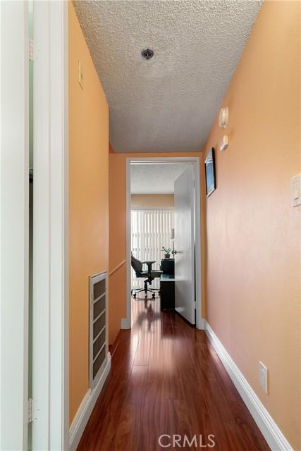 Hallway between two rooms on the second floor.