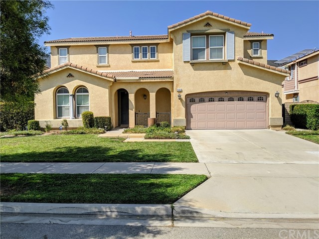 Award-winning Etiwanda School District & a rare opportunity to own one of the prestigious homes Coyote Canyon & Hunters Ridge has to offer! High ceiling upon entry, recessed lighting throughout with inviting foyer upgraded flooring & staircase. Large downstairs master with full bath for the in-laws/guests. The powder room is located near the entry. A massive kitchen flows seamlessly to the family, dining, & living rooms which create an ideal open floor plan. The kitchen features granite countertops & splash, a large center island, stainless steel sink & appliances, an abundance of cabinets for storage, a walk-in pantry, a serving counter & additional storage outside the pantry. The mudroom with counter, cabinets, & sink can be accessed from the garage/backyard. The 2nd floor features a massive bonus room for anything you can imagine adjacent to an additional ensuite bedroom with a full bath & walk-in closet. 2 additional bedrooms down the hall share a full bath with dual vanities. A luxurious master suite is located upstairs with a soaking tub, dual vanities, shower, & a custom walk-in closet along with a laundry room with a sink. For added entertainment, a fully landscaped backyard with fruit trees & an elevated patio area for added entertaining. 3 car tandem garage makes for parking privacy. Perfect for the growing family & that buyer who loves to entertain. Close to major freeways for ease of commute.Stunning mountain views. This home has everything you could want!