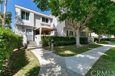 Spacious end unit with the largest patio design. This 3 bedroom 2.5 bath home has lots of natural light and a beautiful bay window in kitchen. Neutral colors to fit your decor with upgraded wood flooring and recessed lighting. Located in a great community close to shopping and freeways.