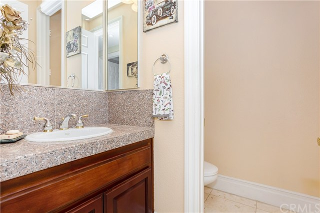 Half Bathroom located on Level 2 near laundry room and Entrance to the 5 Car Garage