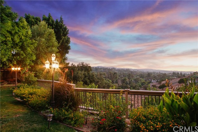 Don't miss this opportunity! High atop Anaheim Hills w/ sweeping valley & city views sits this beautiful CUSTOM VIEW HOME on ~½ acre of land, 4 bedrooms, 3-1/2 bath w/ 4,020 sf of living space. Walk thru the custom double doors & you are greeted by a spectacular entry w/ a magnificent chandelier, highlighting the expansive high-ceiling foyer. First floor includes a spacious living room, formal dining room, bar, modern gas-fireplace w/ stone surround, spacious family room, large laundry room & a huge open gourmet kitchen that includes a 6-burner professional gas stove, twin convection ovens, microwave, walk-in pantry & top of the line stainless steel appliances w/ island seating for 8. All bedrooms are upstairs, including the junior master and an exquisite main master suite & custom walk-in closet. The spa-inspired main master bath comes w/ a soothing tub, multi-head shower & dual sinks. Evoking the sense of peace & tranquility found only in a private resort like oasis. The fully fenced outdoor space is complete w/ planters, BBQ, wet bar, & Gazebo, perfect for entertaining or just relaxing & watching Disneyland fireworks when they start again! This house is located in an award-winning school district it is close to restaurants, bustling retail centers & is minutes away from freeways yet this home feels like its own secluded sanctuary tucked away at the end of the cul-de-sac in the hills!