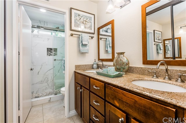 Remodeled master bath with dual sinks. The toilet and shower are separate, providing the utmost in privacy!