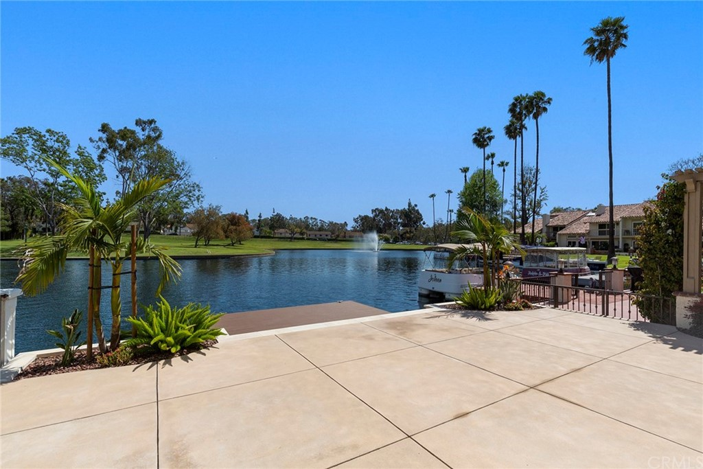 Experience Lakefront Living & Unique Lifestyle of Lake Forest Keys. Premium Lakefront Location with Private Dock & Expansive Lake Views. 5 Bedroom Home includes one Main Level Bed with Private Courtyard or 4 Beds & Den/Office, Formal & Family Dining with Lake View. Beautifully Remodeled in 2017-2019. Kitchen features White Marble Counter Tops on Soft Close Grey Cabinets, GE Stainless French Door Refrigerator, 5 Burner Gas Stove, Microwave, Breakfast Bar, Walk-in Pantry & Lake Views!  Living Room is Light & Bright with Vaulted Ceiling, Stacked Stone Gas Fireplace, Dry Bar with Wine Rack & Frig. All Bathrooms have been totally Remodeled to include New Vanities, Quartz Counters & Laminate Floors. Main Level 3/4 Bath has Large Tiled Shower with Frame-less Glass Enclosure; Upstairs Hall Bath features Dual Sink Vanity & Custom Tiled Tub/Shower. The Spacious Master Suite with Vaulted Ceiling & Private Lakeview Balcony includes a Dressing Area with Three Wardrobe Closets, 3/4 Bath with Walk-in Tiled Shower & Frameless Glass Enclosure. Plus, Re-Piped with Pex Tubing, Dual Pane Windows, Grey Barn Wood Laminate Floors, Newer Carpet, 2 car Garage with Overhead Storage & Large Laundry/Utility Room. Lakefront Patio with Trex Dock Perfect for Entertaining & Prime Location to View Annual 4th of July Fireworks! Membership to Prestigious Sun & Sail Club. See List of HOA Amenities!  Near Irvine Businesses & Spectrum, Fwy & Toll Rds., approx. 11 mi. to Laguna Beach. Low Taxes and No Mello-Roos.