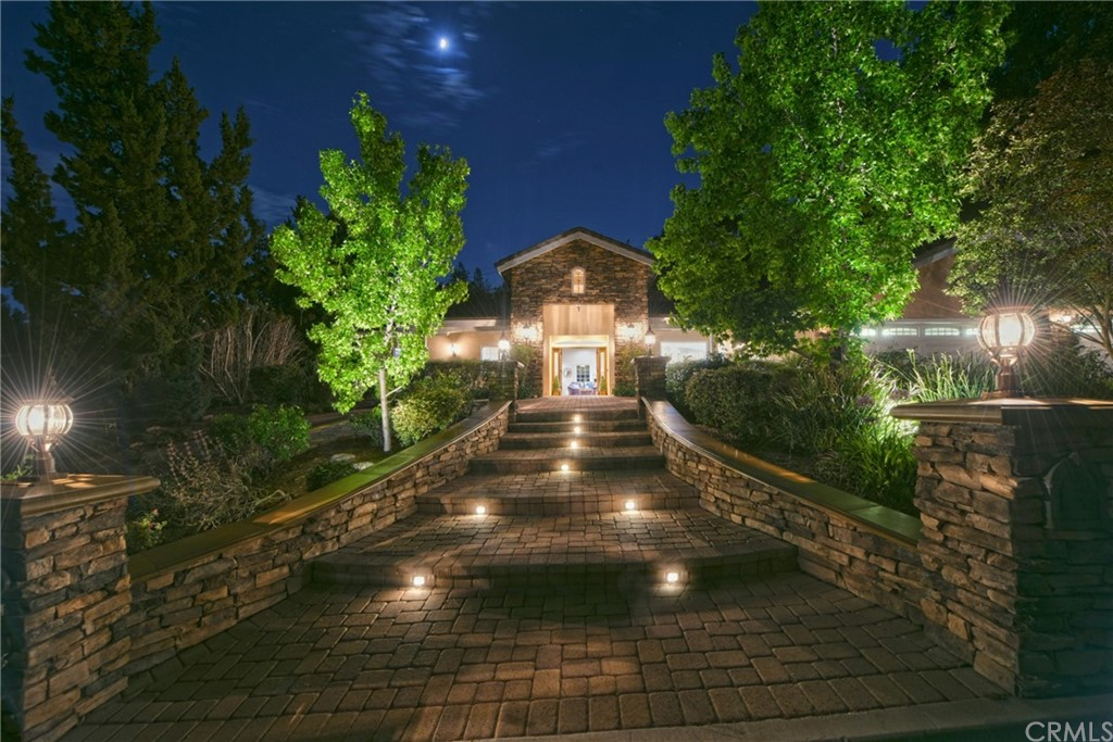 Wonderful opportunity to own Single Level Estate Home on Culdesac in Olinda Village with wonderful Canyon Views. This gorgeous home has an amazing open great room floor plan and was a rebuild in 2004. There are numerous beautiful upgrades and amenities including: high ceilings, gourmet kitchen with large island, farm sink, double oven, warming drawer, vent hood, double drawer dishwasher, built in fridge & referigerator drawers, large walk in pantry, butlers pantry with beverage fridge to large dining room, huge family room with 2 sided fireplace, fan, bar area with granite tops, spectacular main bedroom suite with coffered ceilings, luxury vinly plank flooring, dual walk in closets, french doors to backyard, main bath is stunning with large jacuzzi tub, dual sinks plus vanity are, walk in shower, bidet, 4 good sized secondary bedrooms all with luxury vinyl, bath 2 has steam sauna in shower and bath 3 has another jacuzzi tub, 3 car attached garage with epoxy floors, built ins, central vac, pull down ladder to attic storage, travertine floors, 2 hvac systems and 2 tankless water heaters, surround sound, slate stone back covered patio with vaulted ceiling, fans, fabulous outdoor kitchen with bbq, fridge, sink and bar seating, granite counters, artificial grass, steps up to gazebo and arbor with great views, beautiful garden area, pavered front porch with hanging swing, sitting area, circular driveway, hardscaping walls, pilasters, fountain, great schools, no hoa and no mello roos. This property is gorgeous.