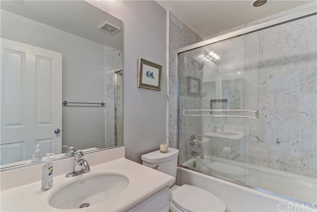 Upstairs full bathroom with updated tub surround