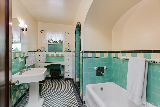 Art Deco Tile Bathroom with separate Tub and Shower, and built-in Vanity