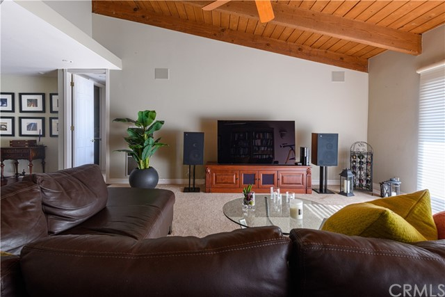 Living Room showing built-in stereo speakers in wall and view of Entry