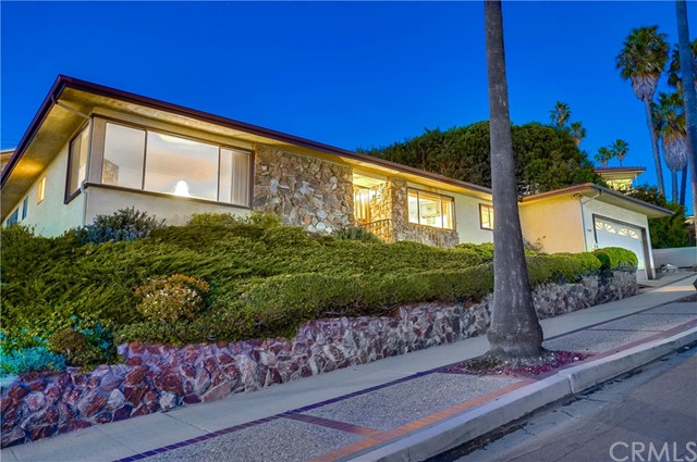 This upper South Shores Mid Century Modern home checks all the boxes beginning with a sparkling Catalina view and amazing sunsets. CHECK! A one-level sprawling floorplan. CHECK! Three spacious bedrooms including a master bedroom with its own dual lav bath. CHECK!  Two additional large bedrooms. CHECK! An inviting sunken living room with PV stone fireplace, enhanced by the captivating Catalina view. CHECK! A family room with a full-sized bar, perfect for relaxing or entertaining. CHECK! An expansive gourmet kitchen, complete with breakfast bar and eating area. CHECK! A functional laundry room with additional storage. CHECK! A sweeping, flat backyard with ample room for a hot tub and an area perfect for alfresco dining. CHECK! An attached two-car garage. CHECK! A security system. CHECK!  This beautiful home has been lovingly cared for ... and it shows. CHECK! Now it's your turn to CHECK IT OUT!!!